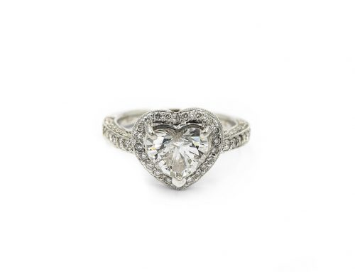 CONTEMPORARY WHITE GOLD AND HEART DIAMOND RING